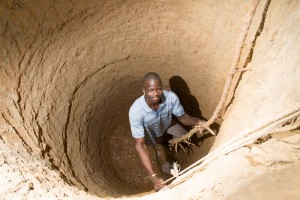 Zougmore Saidou being lowered into a well for excavation in Gomtenga village.  Main Image: Kangabega Ayesto working in Gomtenga's horticultural plot.